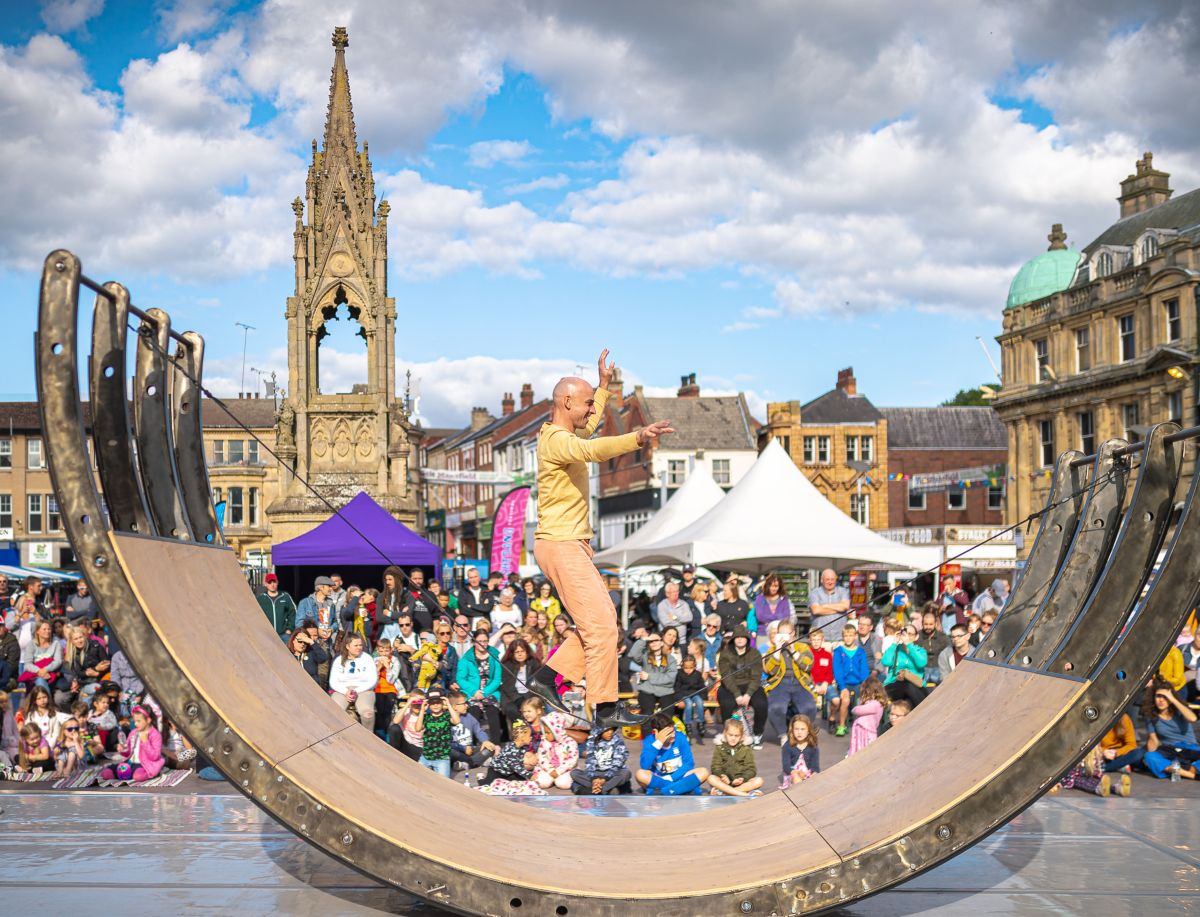 Performer tightrope walking on special structure for the Belly of the Whale at the Full Shebang festival