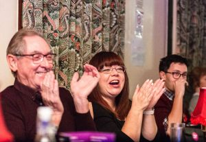 People clapping at the Cabaret Curry Night in Clay Cross hosted by First Art