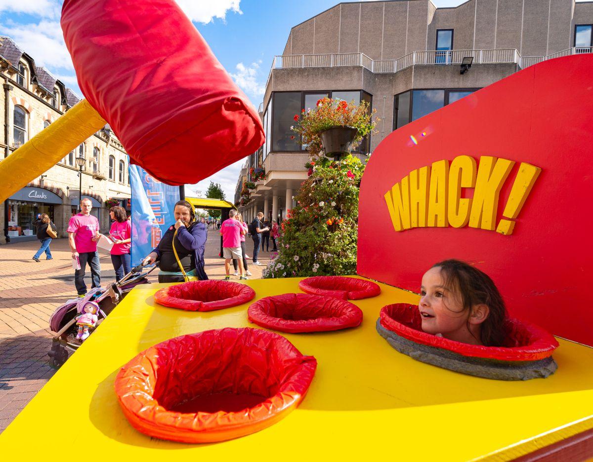 A girl enjoys the Actual Reality Arcade at The Full Shebang Festival 2019