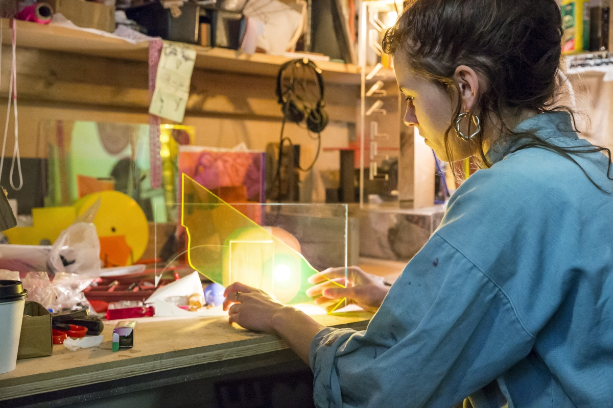 Young woman working on perspex design