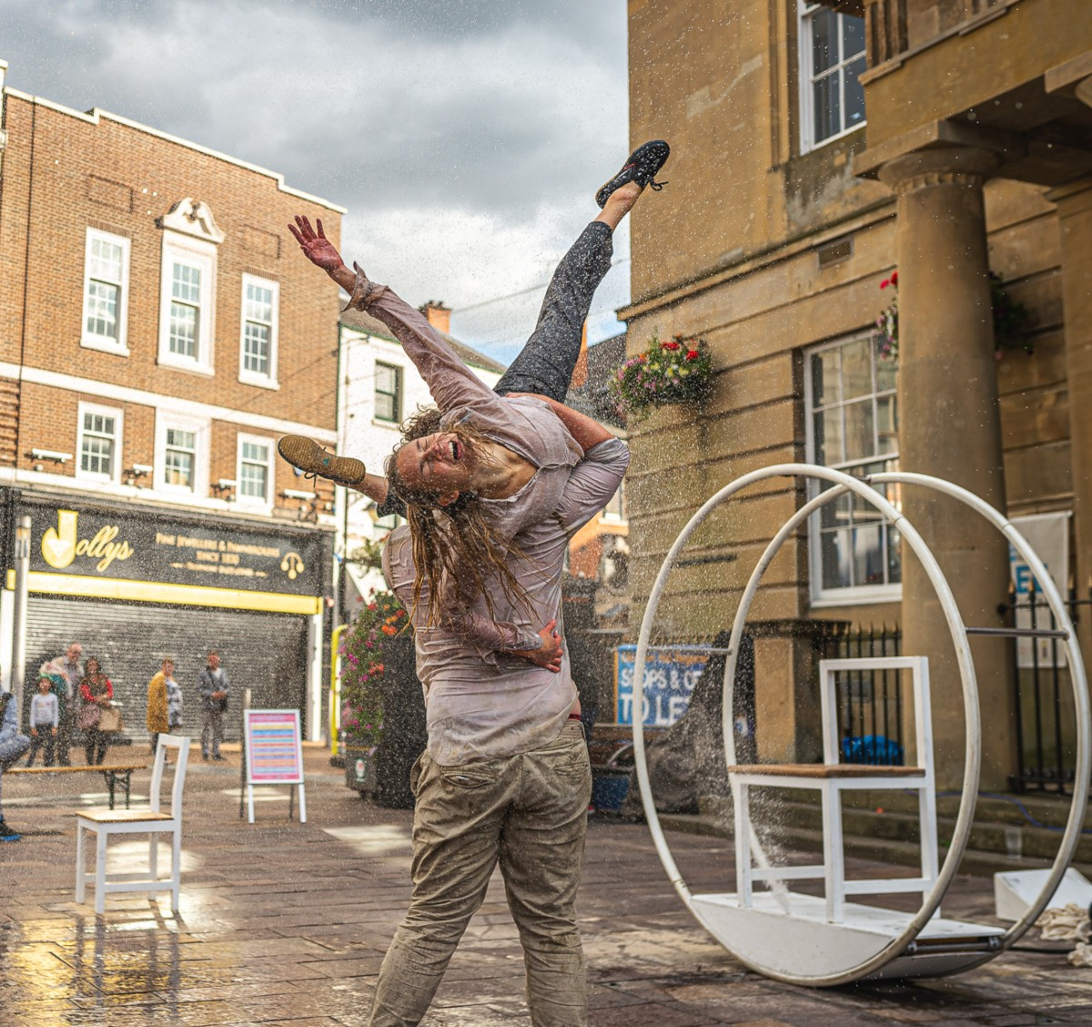 Two dancers perform Frantic in Mansfield Market Place as part of The Full Shebang festival in 2019