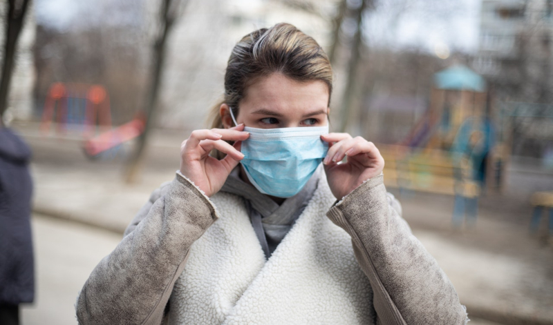 Woman wearing face mask credit EVG Images