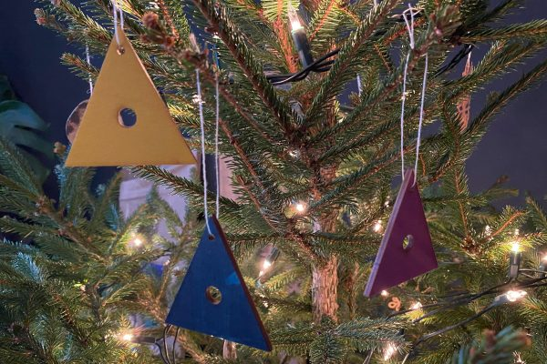 Small plywood decorations on tree