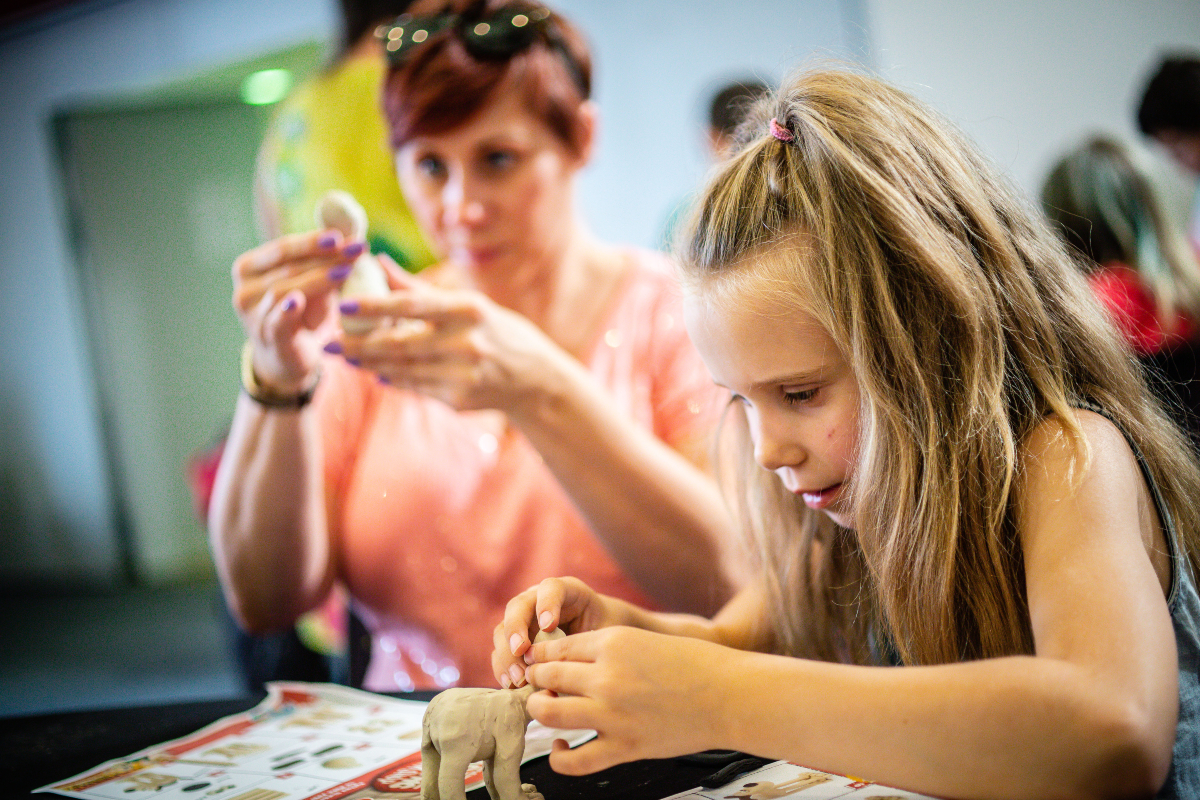 Lady and child making Gromit clay model at Aardman Animations Workshop